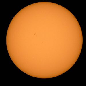 The planet Mercury is seen in silhouette, lower third of image, as it transits across the face of the sun Monday, May 9, 2016, as viewed from Boyertown, Pennsylvania.  Mercury passes between Earth and the sun only about 13 times a century, with the previous transit taking place in 2006.  Photo Credit: (NASA/Bill Ingalls)